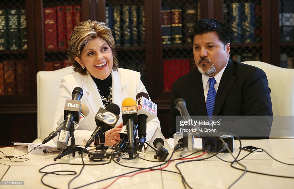 Attorney <a gi-track='captionPersonalityLinkClicked' href=/galleries/search?phrase=Gloria+Allred&family=editorial&specificpeople=213999 ng-click='$event.stopPropagation()'>Gloria Allred</a> (L) and Daniel Ramos speak during a news conference announcing a lawsuit against Kanye West after an attack at LAX Airport on August 21, 2013 in Los Angeles, California.