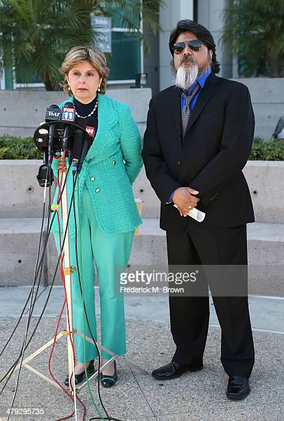 Attorney Gloria Allred and videographer Daniel Ramos speak during a press conference outside of the Superior Court of California on March 17 2014 in...