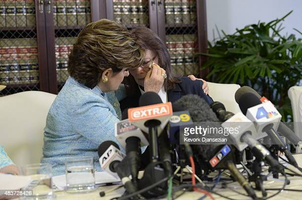 Attorney Gloria Allred comforts Linda Ridgeway Whitedeer one of two women accusing comedian Bill Cosby with sexual assault and one woman accusing...