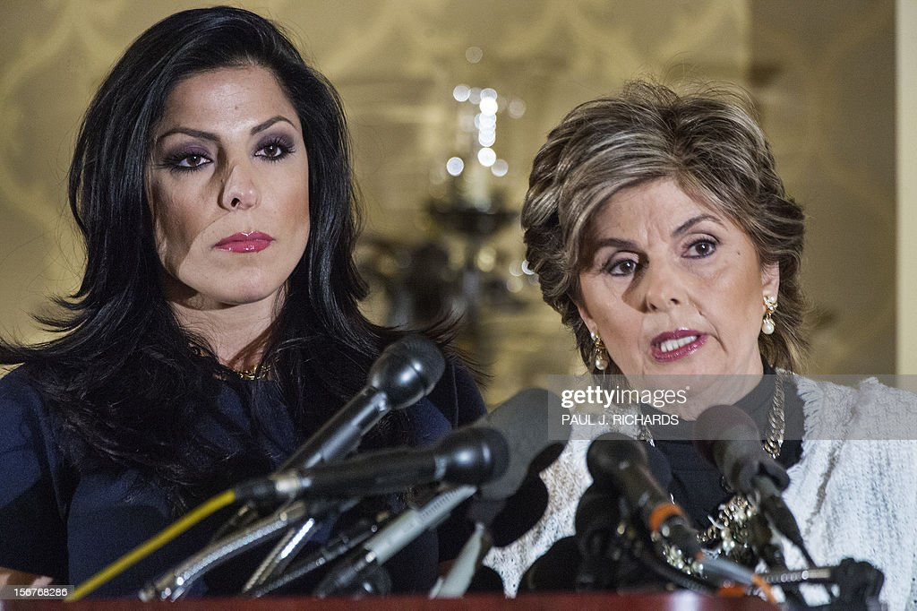 Attorney Gloria Allred conducts a press conference wth her client Natalie Khawam (L) on November 20, 2012 at the Ritz-Carlton hotel in Washington. Khawam is the twin sister of Tampa, Florida, socialite Jill Kelley and wanted to correct misconceptions about her and her relationship with General David Petraeus and his wife Holly. AFP PHOTO/Paul J. Richards .