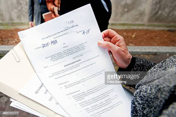 Attorney Gloria Allred holds a copy of the lawsuit filed in Civil District Court on March 4 2015 in New Orleans Louisiana