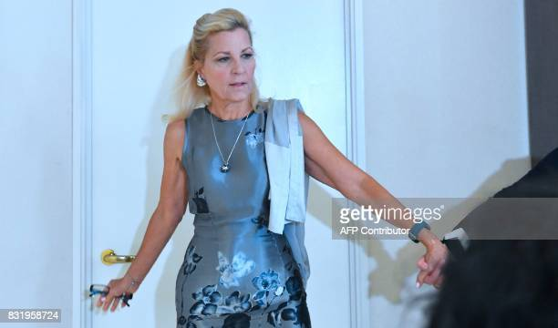 Attorney Gloria Allred leads by hand into press conference room Robin another accuser of Roman Polanski who alleges she was 16 years old when...