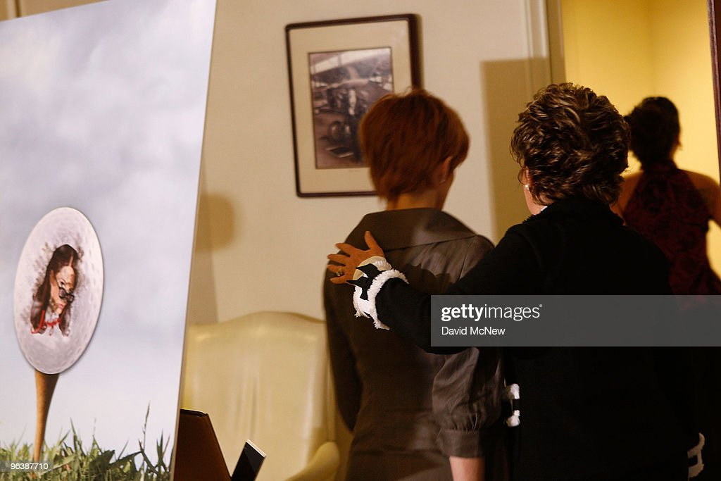 Attorney Gloria Allred (R) leads former adult film actress Veronica Siwik-Daniels (aka Joslyn James), who claims to have had a long-term intimate relationship with golf icon Tiger Woods, near a picture of a golf ball bearing the face of a woman as the leave a press conference at the offices of Allred on February 3, 2010 in Los Angeles, California. Allred and Siwik-Daniels are calling for the end of the production of golf balls bearing an image of Siwik in the product series, 'Tail of the Tiger - The Mistress Collection'. Allred argues that putting the face of a woman on a ball which golfers hit with full force could result in marks on the image that might resemble bruises and may lead to inappropriate jokes about hitting women. James says that she loved Woods and had reason to believe that he loved her. She has been in seclusion and has not talked to the press until now.