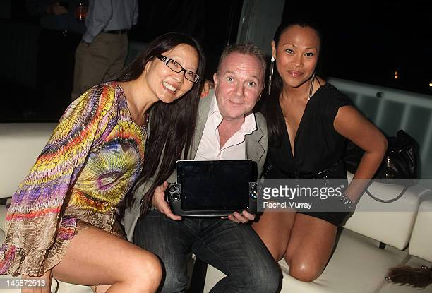 Attorney Joyce Chow WikiPad President of Sales Fraser Townley and actress Cassandra Hepburn arrive at the VIP red carpet cocktail party hosted by...
