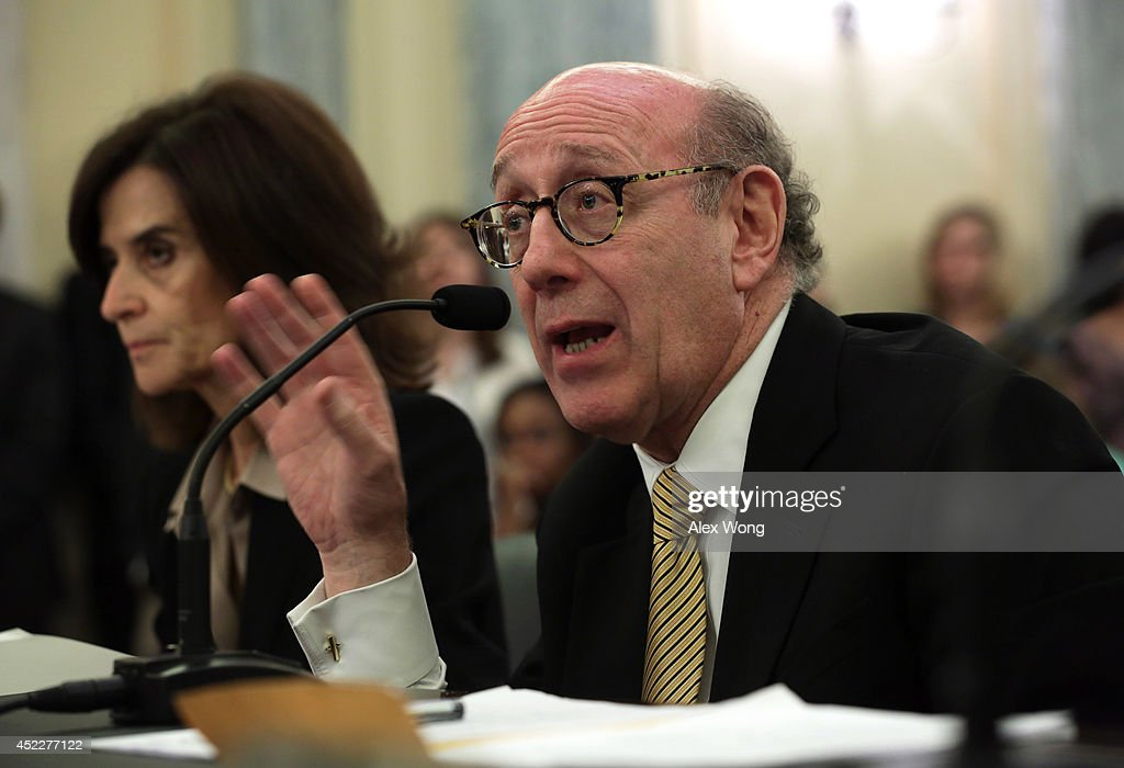 Attorney <a gi-track='captionPersonalityLinkClicked' href=/galleries/search?phrase=Kenneth+Feinberg&family=editorial&specificpeople=1061876 ng-click='$event.stopPropagation()'>Kenneth Feinberg</a>, founder and managing partner at Feinberg Rozen LLP, testifies during a hearing before the Consumer Protection, Product Safety, and Insurance Subcommittee of the Senate Commerce, Science and Transportation Committee July 17, 2014 on Capitol Hill in Washington, DC. The subcommittee held hearing on 'Examining Accountability and Corporate Culture in Wake of the GM Recalls.'