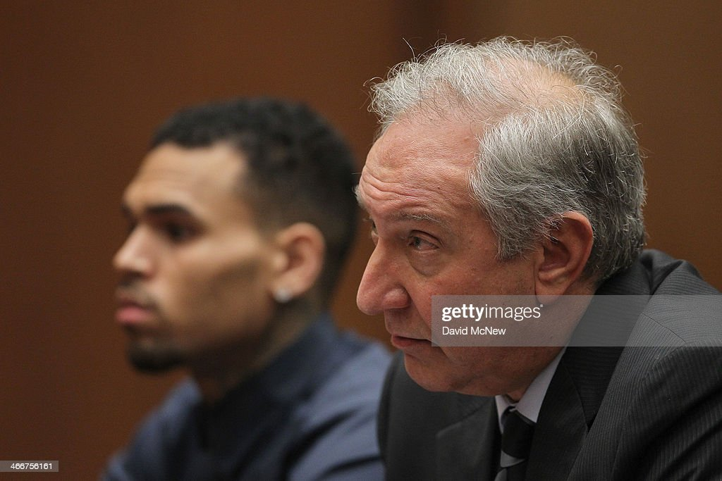 Attorney <a gi-track='captionPersonalityLinkClicked' href=/galleries/search?phrase=Mark+Geragos&family=editorial&specificpeople=201725 ng-click='$event.stopPropagation()'>Mark Geragos</a> (R) and client R&B singer Chris Brown appears in court for a probation progress hearing for Brown on February 3, 2014 in Los Angeles, California. Brown has been on probation since pleading guilty to assaulting his then girlfriend, singer Rihanna, after a pre-Grammy Awards party in 2009. He has been in anger management treatment program and performing community service requirements but failure to meet probation requirements could be even further complicated by assault charges he and bodyguard Christopher Hollosy face stemming from an incident outside the W hotel in Washington D.C. last October.