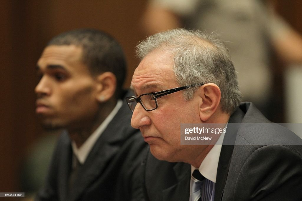 Attorney <a gi-track='captionPersonalityLinkClicked' href=/galleries/search?phrase=Mark+Geragos&family=editorial&specificpeople=201725 ng-click='$event.stopPropagation()'>Mark Geragos</a> appears in court with his client R&B singer Chris Brown (L) for a probation progress report hearing on February 6, 2013 in Los Angeles, California. Brown pleaded guilty to assaulting his girlfriend, singer Rihanna, after a pre-Grammy Awards party in 2009. Prosecutors have alleged that he has failed to meet the terms of his probation.