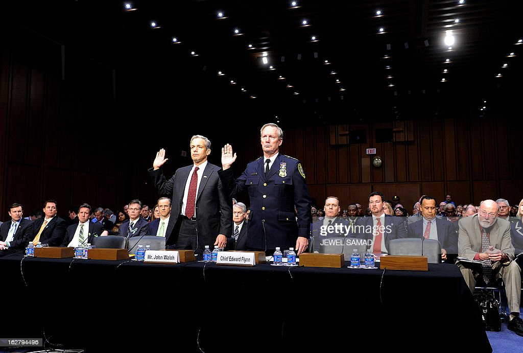 US attorney of the District of Colorado John Walsh (L) and Chief of the Milwaukee Police Department Edward Flynn take oath before testifying during Senate Judiciary Committee hearing on 'The Assault Weapons Ban of 2013' at the Hart Senate Office Building in Washington, DC, on February 27, 2013. AFP PHOTO/Jewel Samad