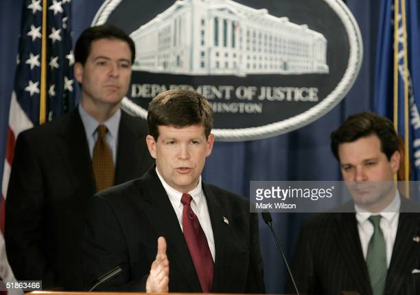 S Attorney Paul Mcnulty of Virginia speaks with Deputy US Attorney General James B Comey and assistant attorney general Christopher Wray during a...