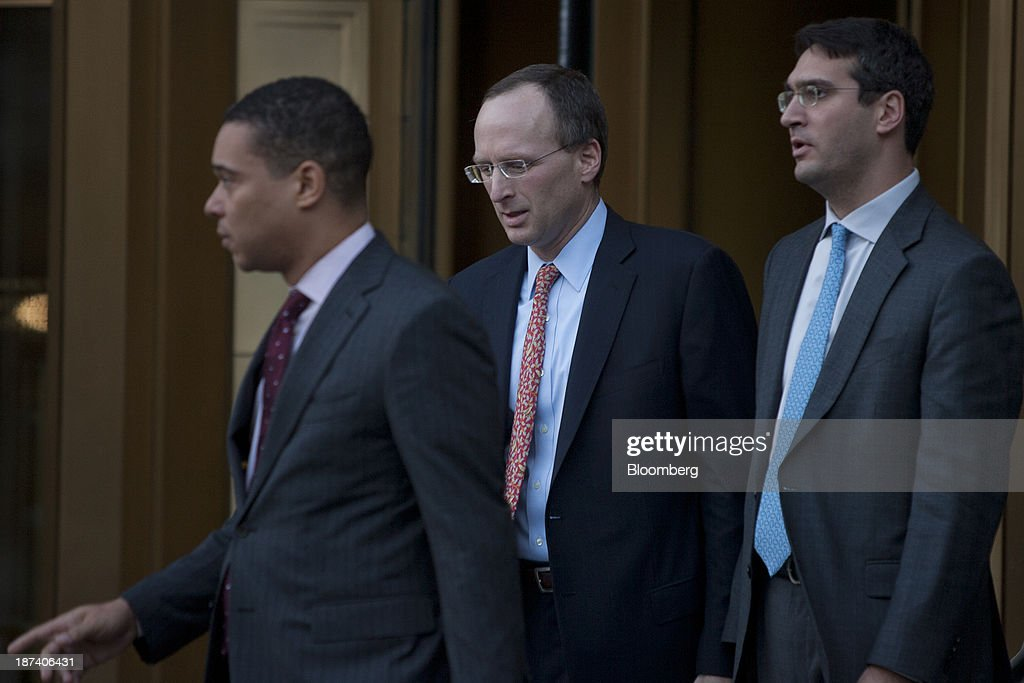 Attorney Peter Nussbaum, center, exits federal court in New York, U.S., on Friday, Nov. 8, 2013. The U.S. judge overseeing SAC Capital Advisors LP's guilty plea to securities fraud said she wouldn't immediately decide whether to accept it, saying she wanted to review the documents first. Photographer: Victor J. Blue/Bloomberg via Getty Images