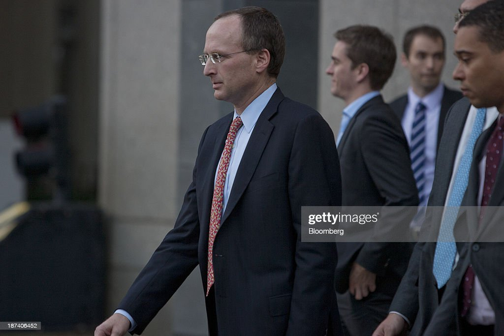 Attorney Peter Nussbaum, left, exits federal court in New York, U.S., on Friday, Nov. 8, 2013. The U.S. judge overseeing SAC Capital Advisors LP's guilty plea to securities fraud said she wouldn't immediately decide whether to accept it, saying she wanted to review the documents first. Photographer: Victor J. Blue/Bloomberg via Getty Images