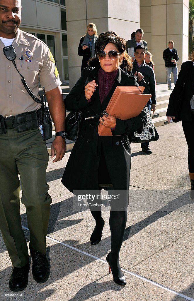 Attorney Shawn Holley, lawyer of actress Lindsay Lohan, leaves the Airport Branch Courthouse of Los Angeles Superior Court on January 15, 2013 in Los Angeles, California. Lindsay Lohan is charged with three misdemeanor counts involving a car crash - willfully resisting, obstructing or delaying an officer, providing false information to an officer and reckless driving. She is also accused of violating her probation in a misdemeanor jewelry theft case.