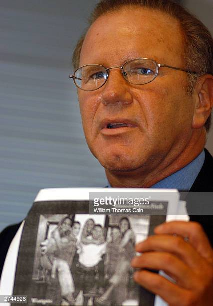 Attorney Sid Gold attorney for Brandy Hawk not shown holds up an example of Abercrombie Fitch's 'profile' during a news conference announcing a...
