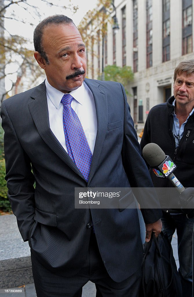 Attorney Ted Wells, left, speaks to the media before entering federal court in New York, U.S., on Friday, Nov. 8, 2013. SAC Capital Advisors LP will plead guilty to insider trading-related charges in Manhattan federal court today. Photographer: Louis Lanzano/Bloomberg via Getty Images