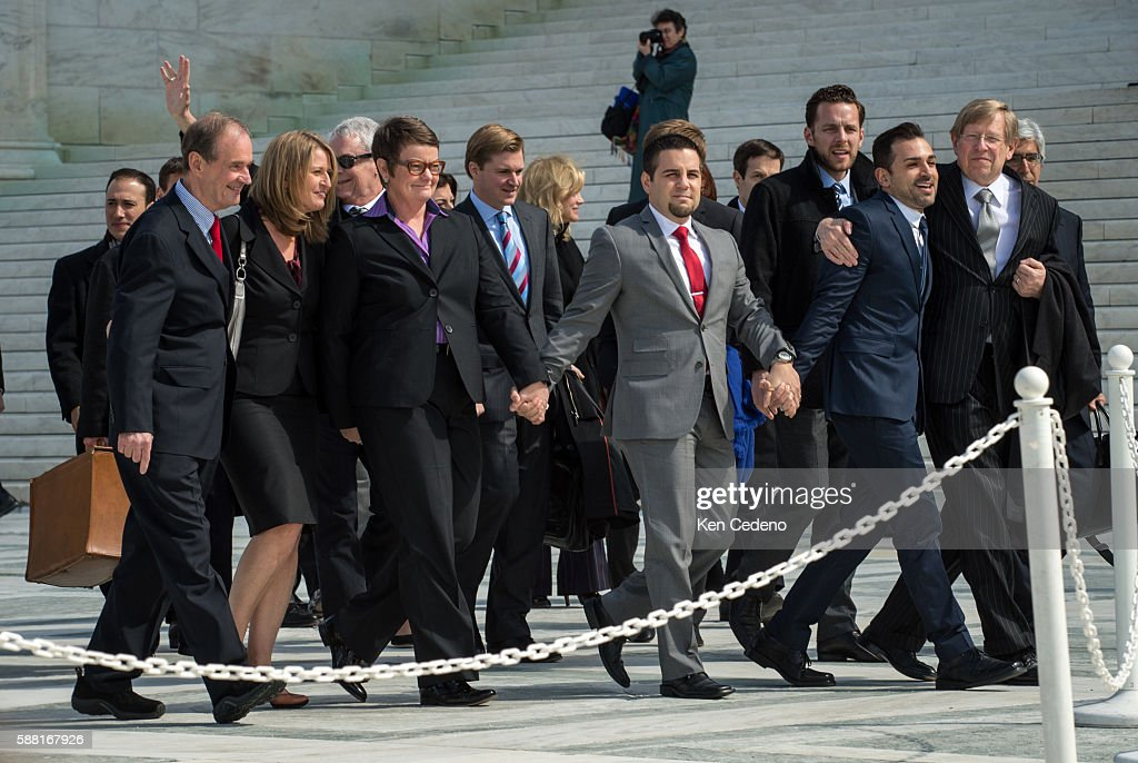 Attorneys for plaintiffs David Bois far left and Theodore Olson far right walk out of the US Supreme Court with plaintiffs from left Sandy Stier Kris...