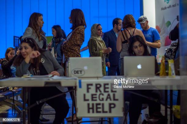 Attorneys offer free legal help to arriving international travelers on the first day of the the partial reinstatement of the Trump travel ban...