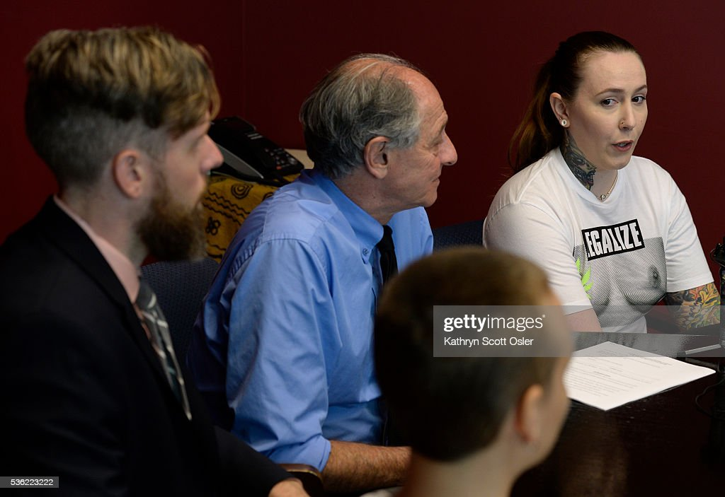 Attornies Andy McNulty, left, and David Lane, second from left, answers questions with plaintiffs Samantha Six, right, and Brit Hoagland during a press conference at the law offices in Denver. The two women wore t-shirts with a photo of bare breasts on the front of the shirt. The law firm of Killmer, Lane & Newman, LLC in Denver has filed a complaint in the US District Court on the behalf of plaintiffs in Fort Collins, CO that want to eliminate sexist statutes from the books and wish to bare their breasts publicly in Fort Collins without fear of arrest. A Fort Collins statute criminalizes women's nipples being publicly exposed, but not men's nipples. (Photo by Kathryn Scott Osler/The Denver Post via Getty Images)The law firm of Killmer, Lane & Newman, LLC in Denver has filed a complaint in the US District Court on the behalf of plaintiffs in Fort Collins, CO that want to eliminate sexist statutes from the books and wish to bare their breasts publicly in Fort Collins without fear of arrest. A Fort Collins statute criminalizes women's nipples being publicly exposed, but not men's nipples.