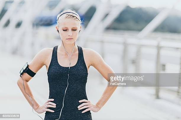 Attractive adult female listening to music before