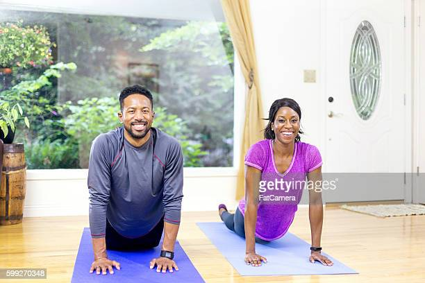 Attractive African american couple holding a yoga pose