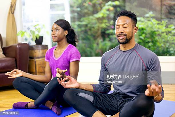 Attractive African american couple meditating