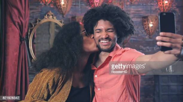 Attractive African American Couple take Selfie While Kissing