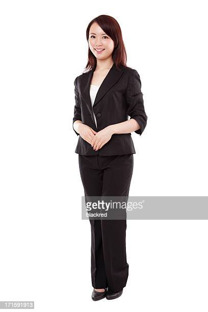 Attractive Asian Businesswoman in Suit on White Background