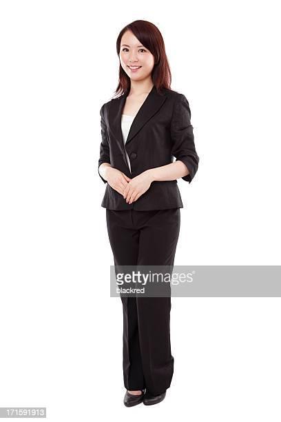 魅力的なアジアのビジネスウーマンのスーツに白背景
