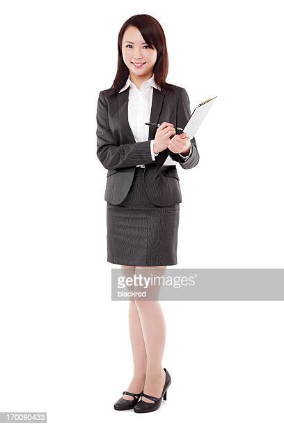 Attractive Asian Businesswoman Taking Notes Smiling on White Background