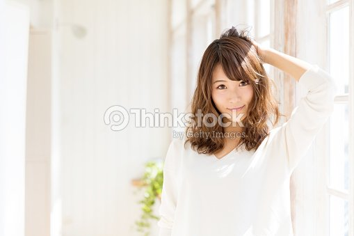 attractive asian woman in living room : Stock Photo