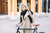 Attractive Blond Female CEO Cycling To Work