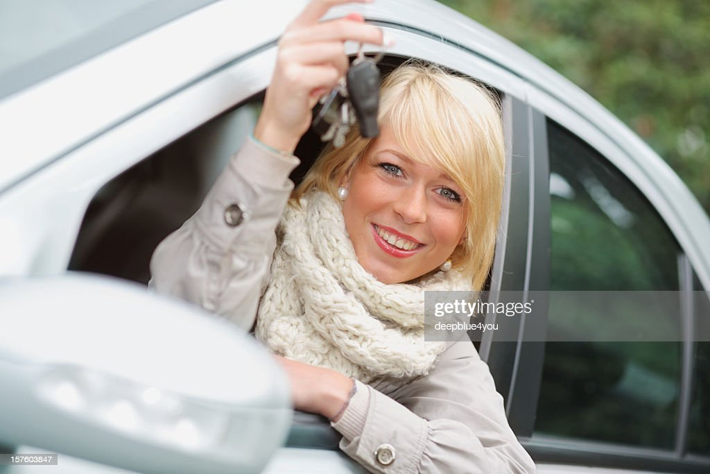 Attractive blond teenager shows her car key : Stock Photo