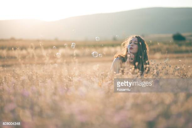 Attractive Bohemian Girl Blowing Bubbles