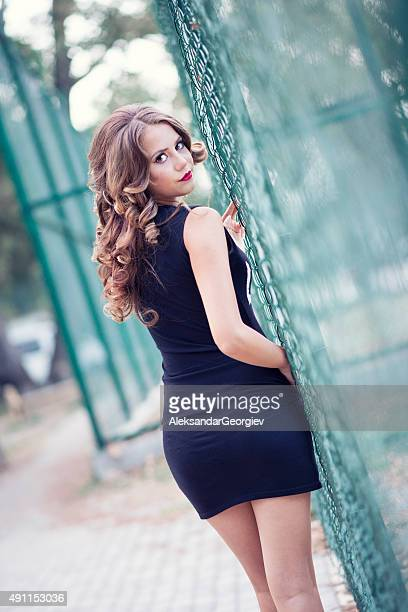 Attractive Brunette Woman Posing by Playground in City Park