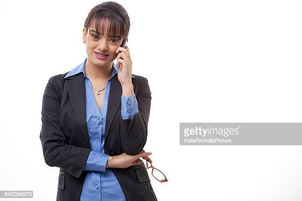 Attractive business woman using mobile phone over white background