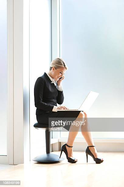 Attractive Businesswoman Very Busy On Her Cellphone