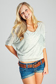 Attractive Casual Young Blonde Woman on Gray Backdrop