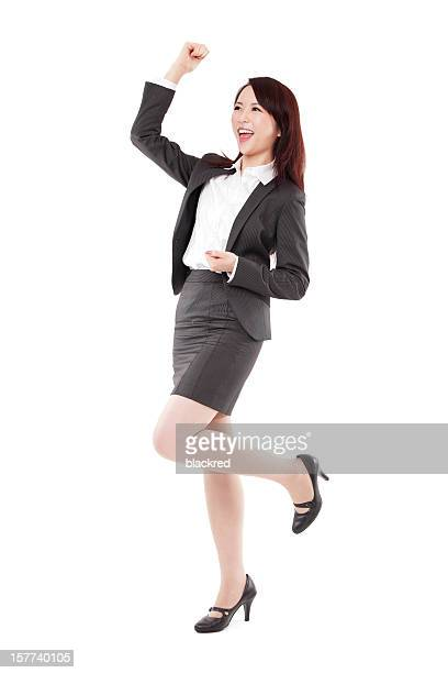Attractive Chinese Businesswoman Celebrating Arm Rised on White Background