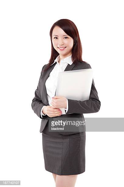 Attractive Chinese Businesswoman Holding Documents Smiling on White Background