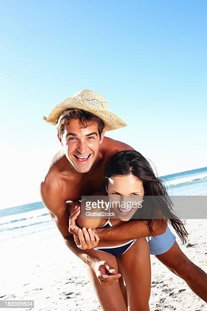 Attractive couple being playful on beach