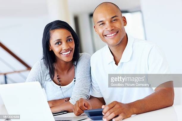 Attractive couple calculating expenses