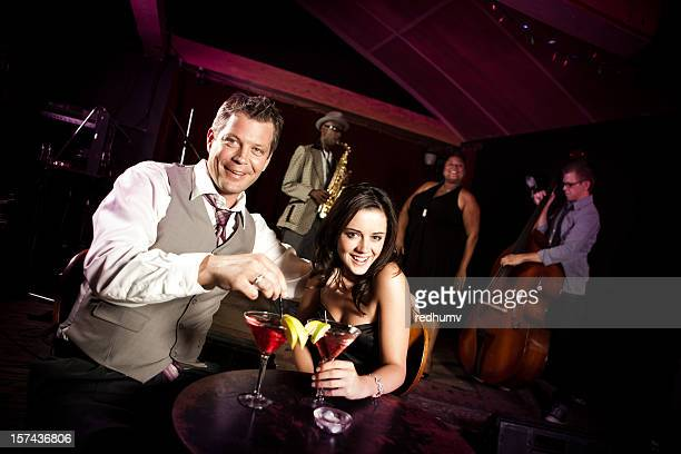 Attractive Couple Enjoying Drinks at Nightclub Bar