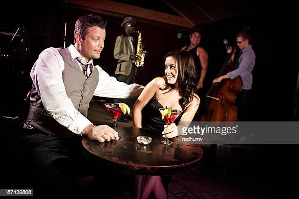 Attractive Couple Enjoying Drinks at Nightclub Bar