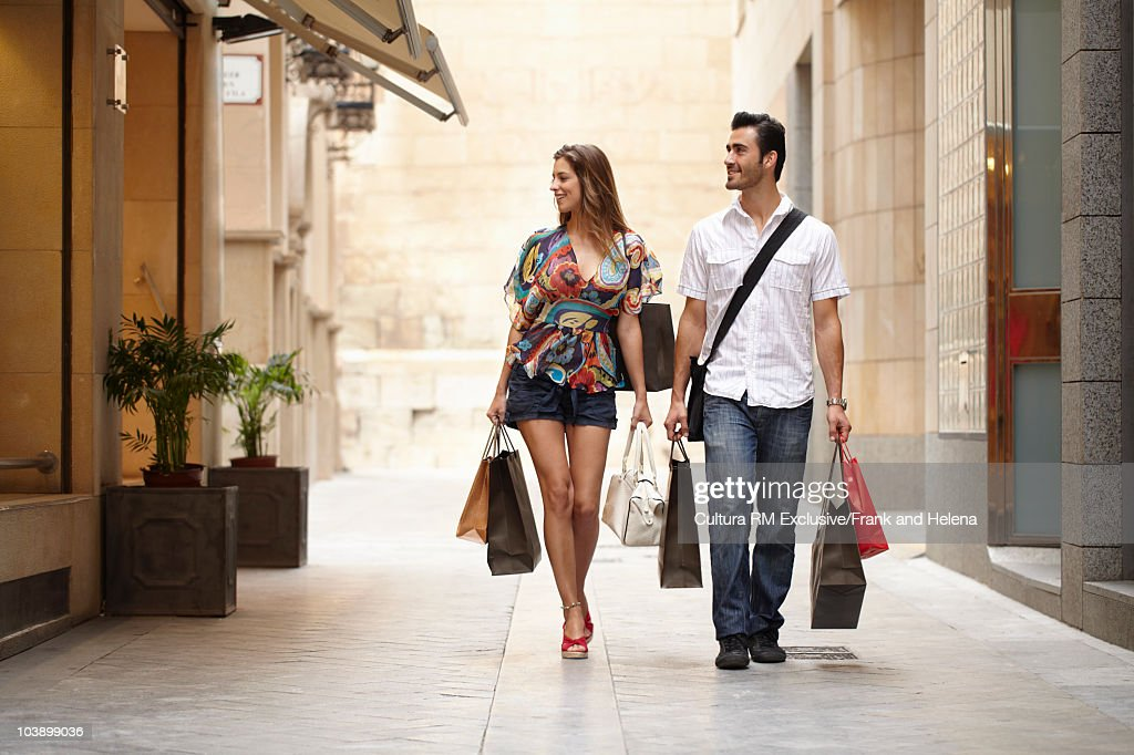 Attractive couple on shopping spree : Stock Photo