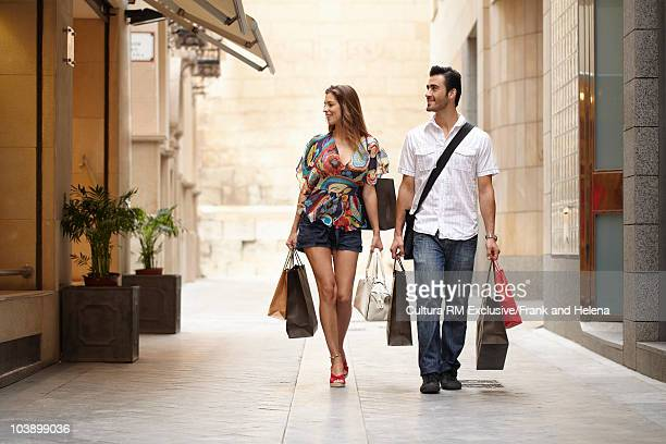 Attractive couple on shopping spree