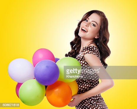 Attractive elegant woman with balloons : Stock Photo
