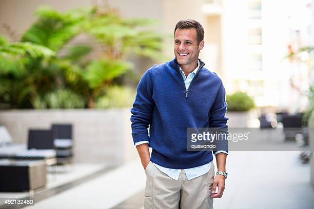 Attractive Fashionable Male Model In Pullover and Khakis