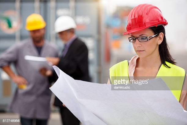 Attractive female construction architect