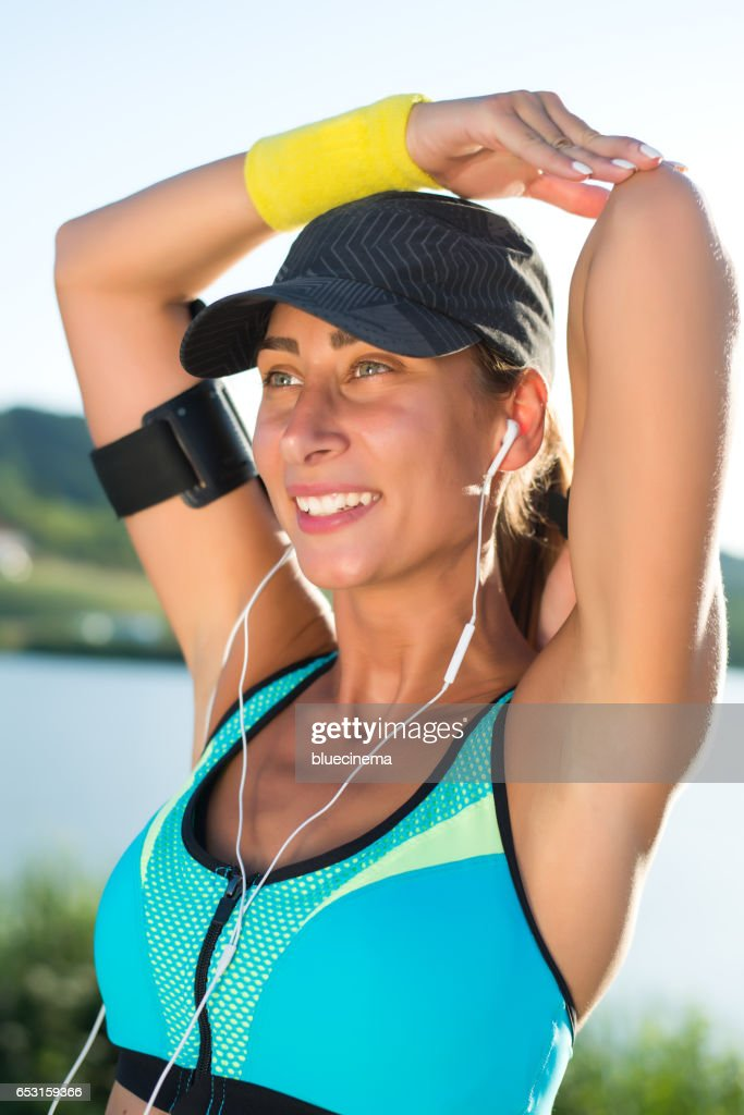 Attractive female doing stretching exercise : Stock Photo