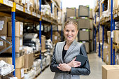 Attractive female manager in distribution warehouse