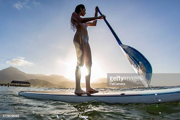 Attractive Female Paddle Boarding